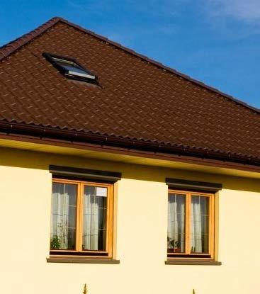 Окна в стене и крыше дома