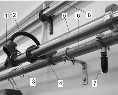 Система трубопроводов с молочным краном на молокопроводе